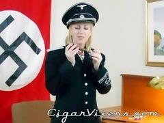 morina smokes a cigar