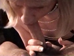 vintage carli in leather getting facial from a