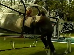 guy takes busty blond on a helicopter ride