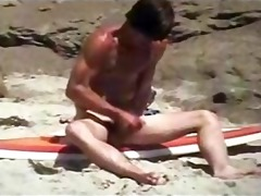 beach boy waxes his boaed